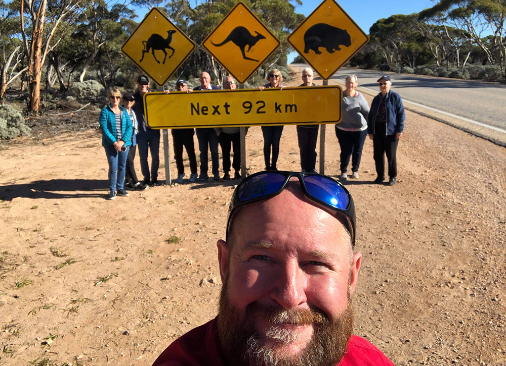Chris with a group at the famous 92km straight sign