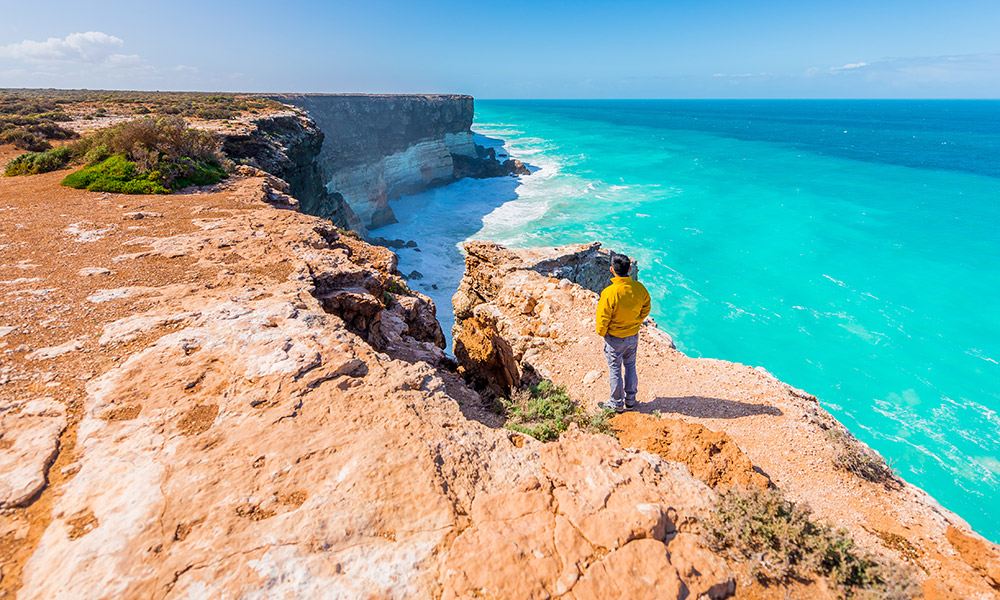 A man standing at the Great Australian Bight